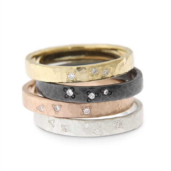 Katie g. Jewellery - Wide Hammered Rings with stargazing setting diamonds